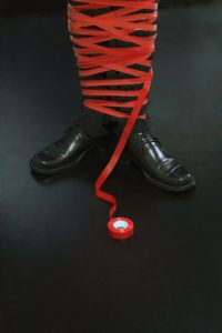 26383498 - businessman tied up in red tape